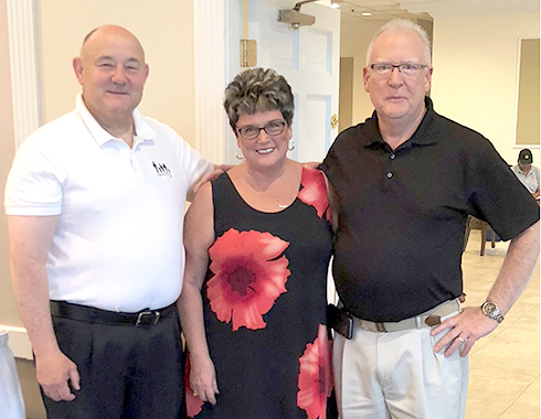 Three area residents were honored for 25 years of service to Together We Cope. From left are Frank Trombley of Country Club Hills, and Mary Ann and Bill Baer of Orland Park.