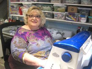 Karen Persing at her sewing machine